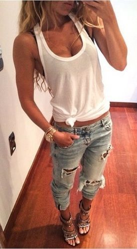 Ripped boyfriend jeans, a tied up white tank and embellished heels make for the perfect casual going out outfit.