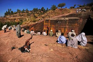 Pilgrims-relaxing-above-the-church-of-Saint-George,-Lalibela,-Ethiopia.jpg