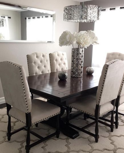 These pin tuft chairs are really good for the dining room. Not for breakfast bar with kids though. Also can do two tufted head chairs with contrasting side chairs that are not tufted and more wood than fabric? Just a thought. -A
