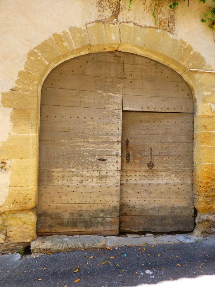 Street entrance to oldest home in Loumarin, Provence, France - 1573