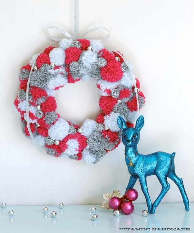 DIY Holiday Wreaths Make Awesome Homemade Christmas Decorations for Your Front Door | Cool Crafts and DIY Projects by DIY JOY | Holiday Pom Pom Wreath | http://diyjoy.com/diy-christmas-decorations-wreaths