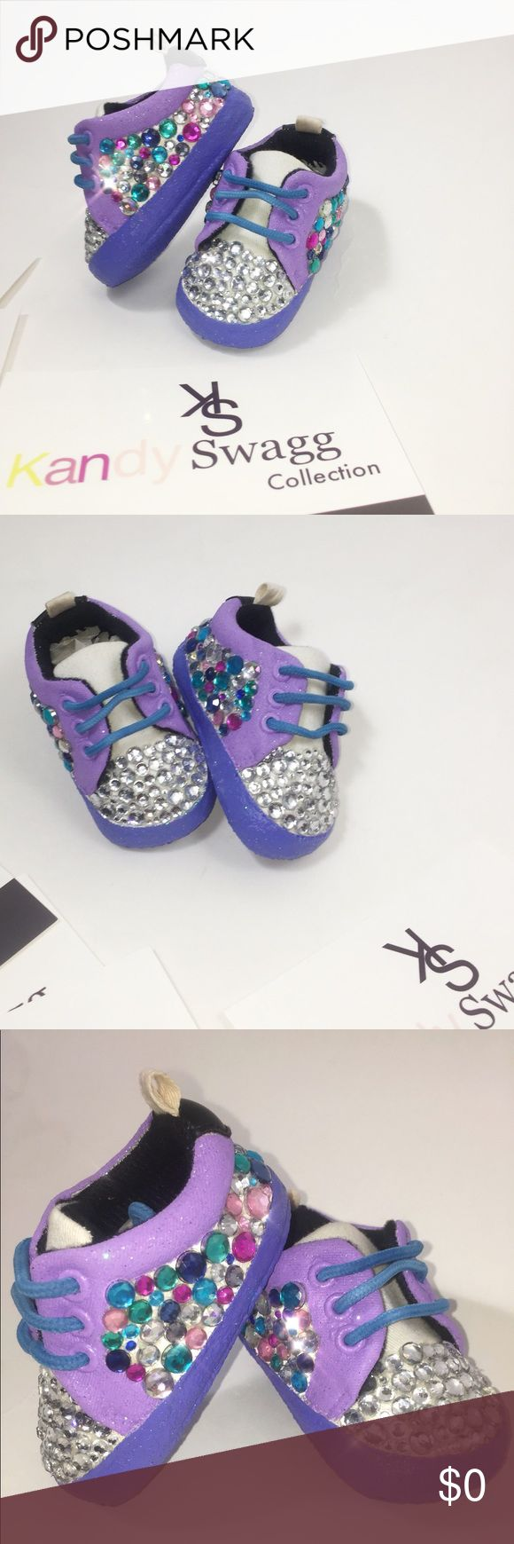 Purple skittles Our Purple skittles are a girls dream! Full rhinestone shoe half rhinestone tongue, follow us on FB & IG @KandySwaggc for videos of out products:) kandy Swagg Shoes Baby & Walker