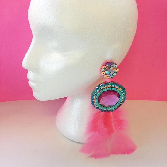 Hand Embroidered Earrings These stunning and incredibly sparkly pink and turquoise dangle earrings are made with surgical steel, hypo-allergenic studs. They are very light weight because of the materials used, being made with sequins that are hand sewn onto felt, with beads.