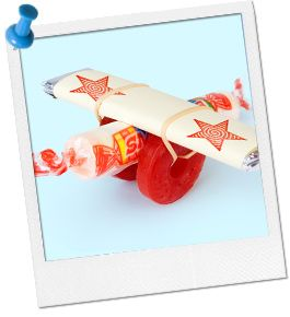 Candy Airplane Craft  What You'll Need: A thin rubber band, One roll of Smarties candy, or a thin Tootsie Roll, or other similar shaped candy, Two white Life Saver candies, such as peppermint, Two sticks of gum, any flavor.