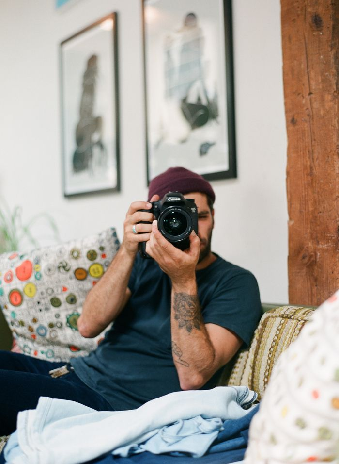 Male, man, guy, behind camera, tattoo, arms, hands, fingers, focus, concentration, photograph, photo