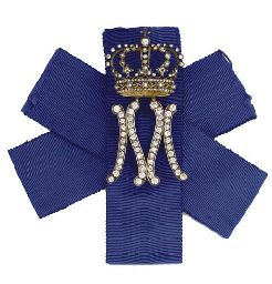 A-LADY-IN-WAITING'S MONOGRAM CYPHER BADGE FOR MARIA-JOSÉ, QUEEN OF ITALY, BY MUSY, TURIN, CIRCA 1930. Designed as a diamond-set initial M with crown above on blue silk ribbon, mounted in silver and gold.
