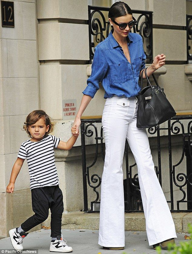 That 70's Siren: Miranda Kerr leaves her New York apartment on Thursday with her three-year-old son Flynn