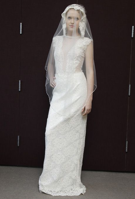 Brides.com: Pat Kerr - Spring 2013. Lace sheath wedding dress with an illusion high neckline, side cutouts, and cap sleeves  See more Pat Kerr wedding dresses in our gallery.