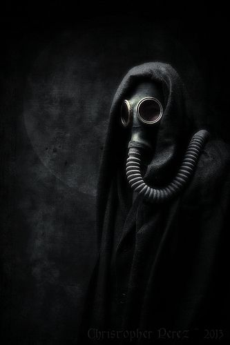 This image is so dark, yet it lets one create a story from its simple creepiness. I imagine a mad survivor of some apocalypse still wearing their gas mask years later.