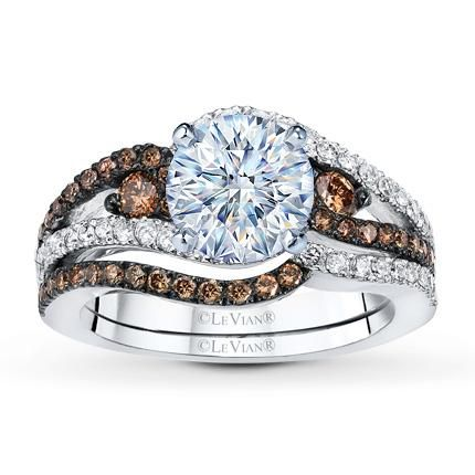 Chocolate Diamonds® spiral on either side of the center, met by waves filled with Vanilla Diamonds® above and below, in this captivating engagement ring setting from the Le Vian® Bridal™ collection