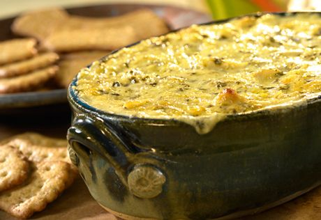 When you really want an appetizer that will impress your guests, this is the one to make. It combines spinach-artichoke spreadable cheese and lump crabmeat, that's baked until hot and golden...it's so good!