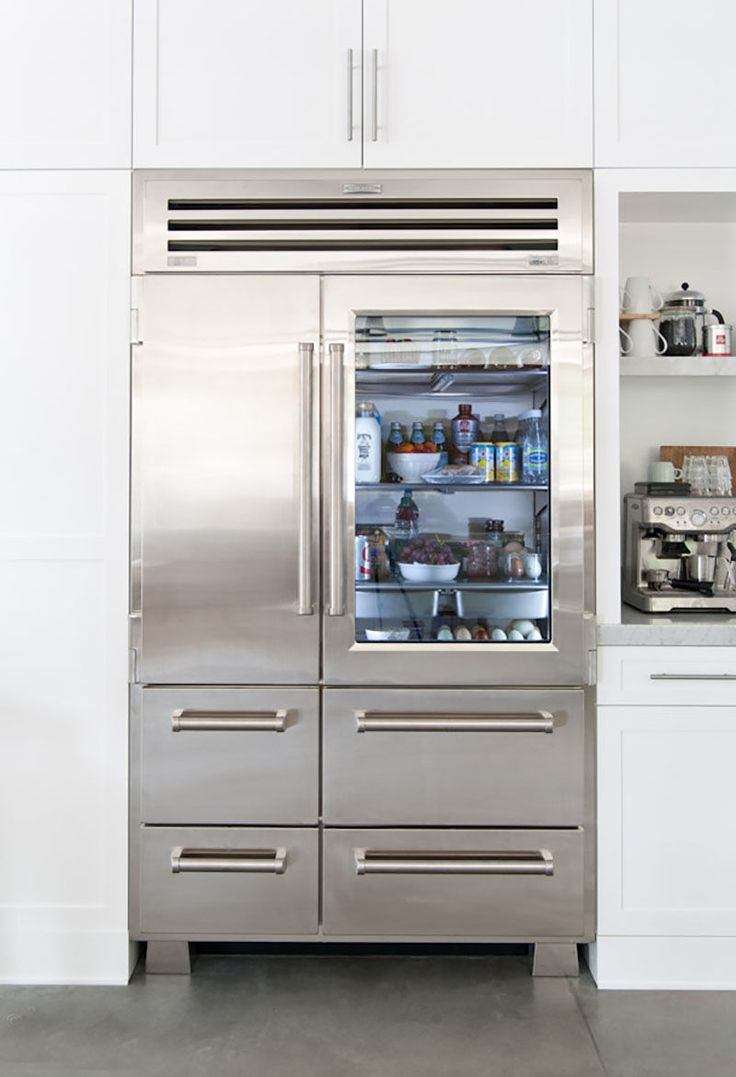 kitchen remodel with Sub-Zero Glass Door Refrigerator  is this side by side or freezer combo? ... not crazy about mix of drawers & doors,