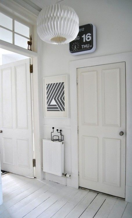 white wood floors + stripes + origami style pendant