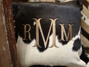 Monogrammed cowhide pillow- i die. @Samantha @This Home Sweet Home Blog @AbdulAziz Bukhamseen Home Sweet Home Blog Blythe I thought of you