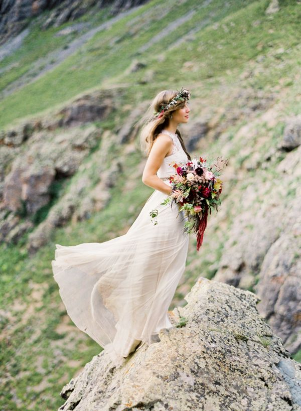 Beautiful backdrop of the San Juan Mountains used in this wedding shoot by Brumley & Wells. Floral crown and bouquet, by April's Garden. Dress by BHLDN.