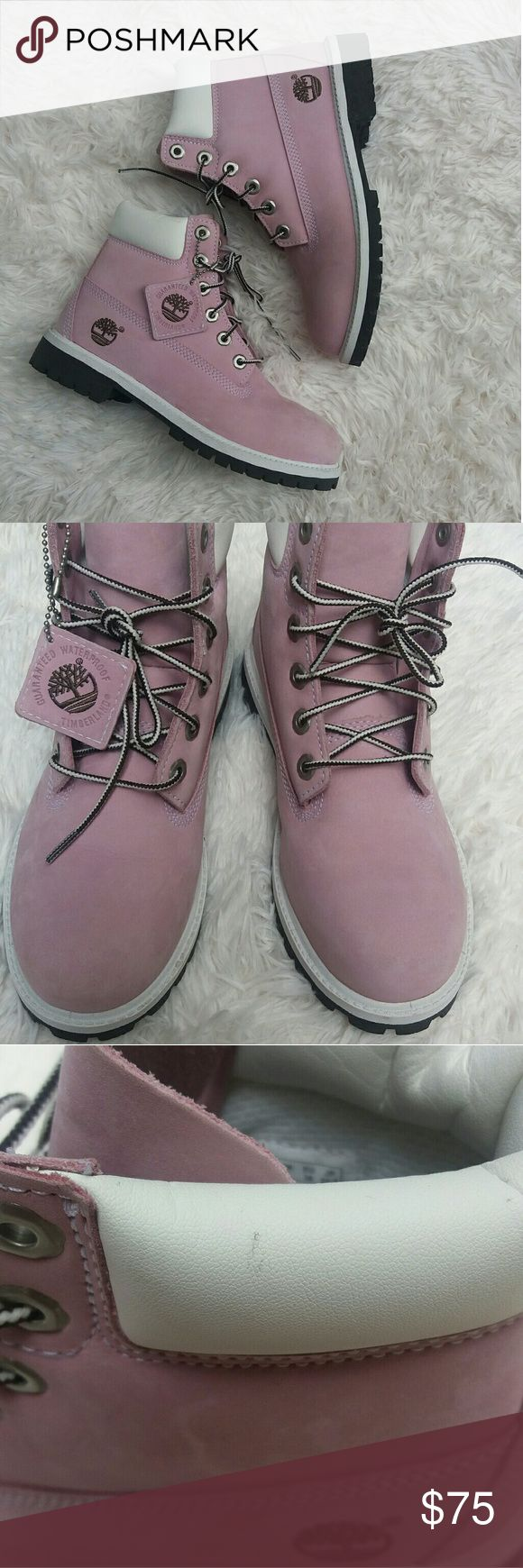Pink Timberland Boots Pink Tims in girls size 5.5 but runs HUGE and fits womens 7.5-8. Few light scuff marks on the collar and small crease on front of the right boot (as shown in listing) but is otherwise in like new condition. Timberland Shoes Winter & Rain Boots