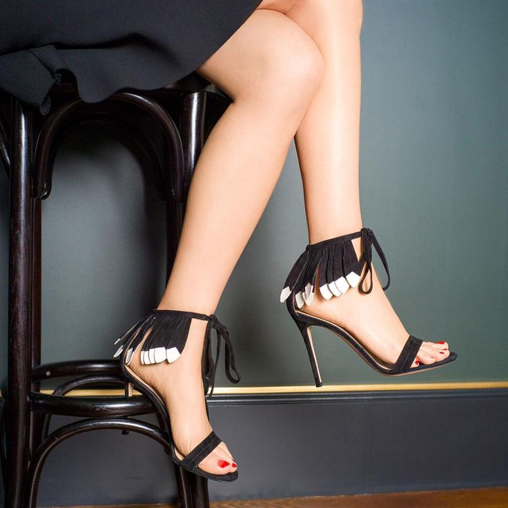 """Step out of your comfort zone with these high heel sandals with a feather ankle tiara"""