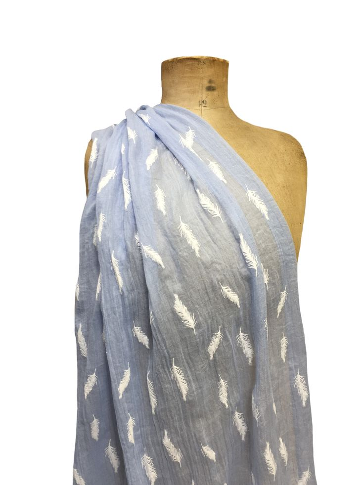 Hem&Edge scarf with feather mono sky blue print 65% viscose 35% cotton 70x180cm #beautifulblues #scarf #accessories #onebutton #hemandedge Click here to see more products from the One Button shop.