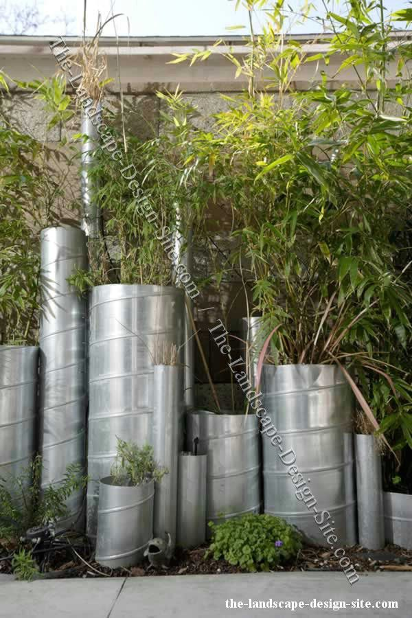 Vertical metal pipes as planters and garden decor for Decorative garden accents