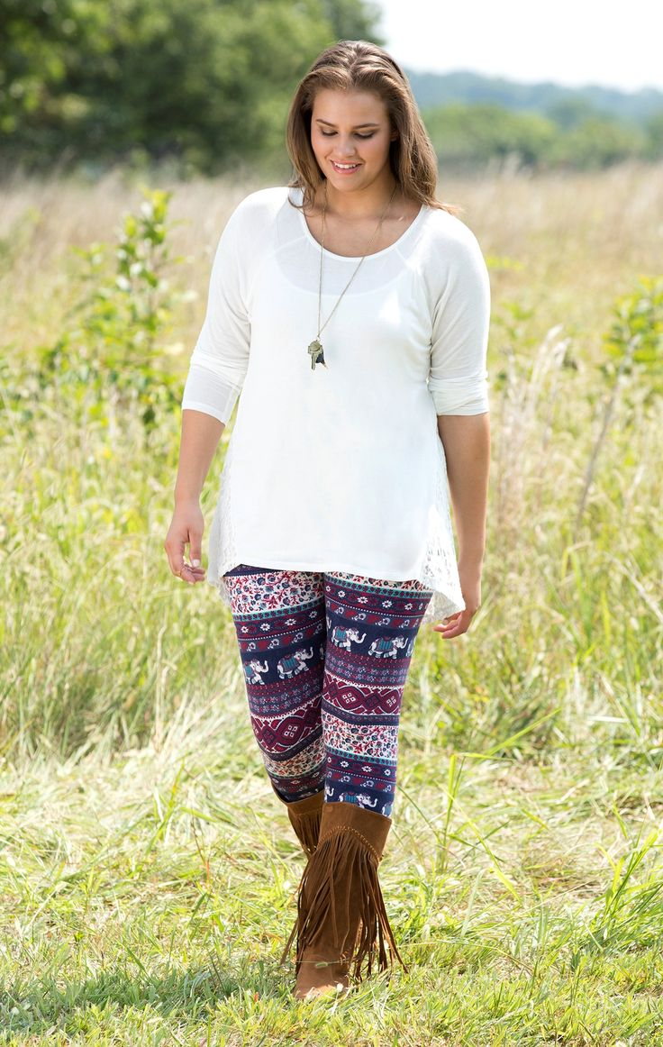 Colorful leggings with a solid top and boots, long pendant to accessorize
