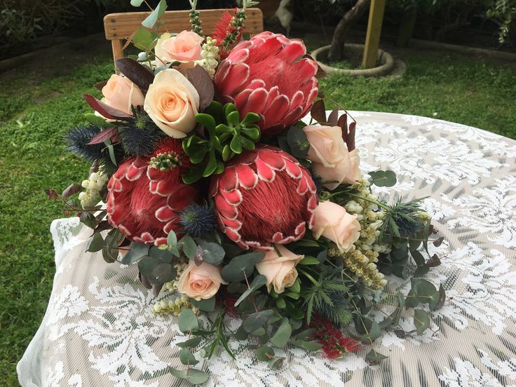 Proteas teamed with cream roses @weddingflowers