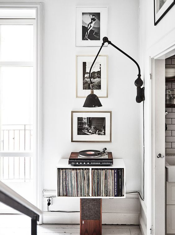 Photographer Kalle Gustafsson apartment styled by Dusty Deco with vintage interior. Vinyl player, records, photo art, white, black, wood..
