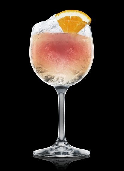 ABSOLUT Sangria Rosada - Fill a wine glass with ice cubes. Add all ingredients. Garnish with orange. 2 Parts ABSOLUT CILANTRO, 2 Parts Pomegranate Juice, 2 Parts Sparkling Wine, ½ Part Lime Juice, 1 Wheel Orange