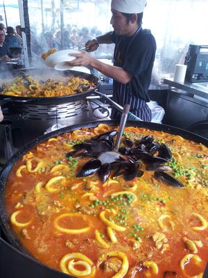 Simply Spanish @ South Melbourne Market - street-side paella is a must! See how you can live close by at www.gracerealty.com.au