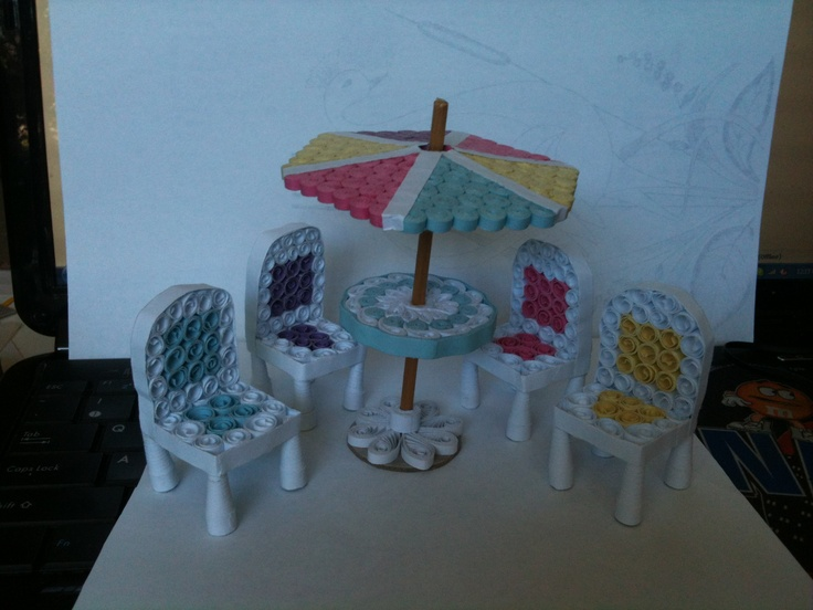 Outdoor furniture complete with umbrella. Made entirely from paper