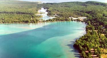 Torch Lake, Michigan - yes, you read that correctly...this beautiful, crystal-clear, Caribbean-like water is found in Michigan.  Great place for boating (and partying!)  Beware -unlike the Caribbean, the water is COLD!