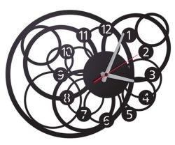 Galactic clock will be a strong element in salon  or hall despite smooth ornamental opening.  It is a great idea for somebody who likes  modern design.