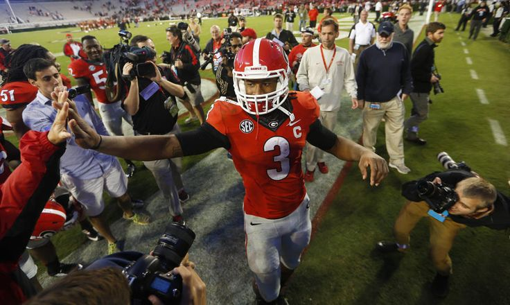 No. 1 MSU, No. 4 'Bama meet in Tuscaloosa FILE - In this Oct. 4, 2014, Georgia running back Todd Gurley (3) celebrates with fans after defeating Vanderbilt 44-17 in an NCAA college football game in Athens, Ga. After serving a four-game suspension for taking money for autographs, Georgia's star running back returns for a big one _ the 16th-ranked Bulldogs hosting ninth-ranked Auburn.(AP Photo/John Bazemore, File)