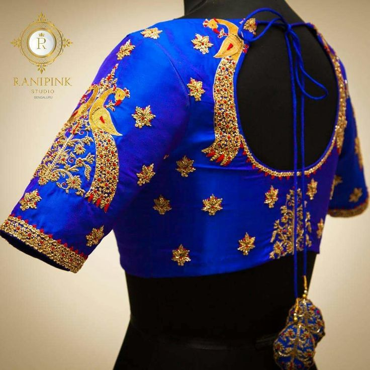 An intricately designed royal blue blouse.<br>Royal blue blouse with peacock design on sleeves and tie back with latkans on back with overall flower design in zardozi. 22 December 2017