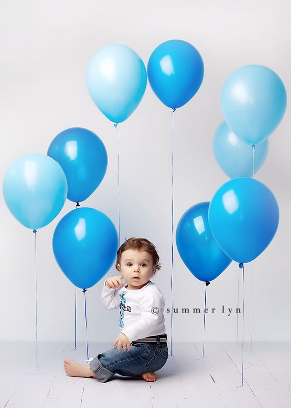 Tape balloons at different lengths for backdrop...First year birthday photos