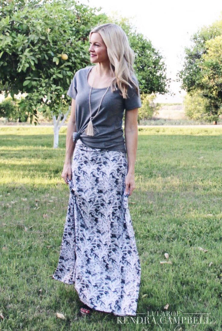 Lularoe maxi skirt and classic tee knotted on the side. This lace-look print is a little bit boho. Click link to shop LuLaRoe and for more style inspiration and giveaways.