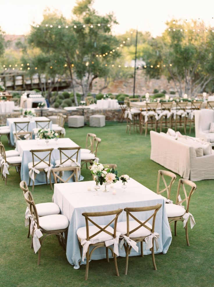 Wedding Rentals With Square Tables Powder Blue Linens Hanging Lights And Outdoor