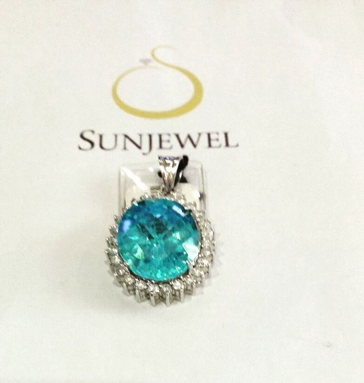 SUN03095-0 Swiss Blue Pendant W/ Diamonds by Sunjewel Elite  Round Diamond 1.29 Carat (26pcs) Colored 7.05 Carat (1pc) Gold 7.8 Grams White Gold 14-Karat  We offer 12 mos. 0% Interest on major Credit Cards, and up to 18 mos. 0% Interest on your BPI Cards  Contact Sunjewel Team for discounts/promos & further inquiries Mobile/Viber: 0915.3098288 / 0917.8036244 / 0915.6085158 Tel: 910.3407