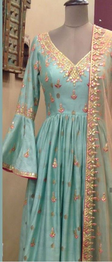 787c67fbdd Beautiful Hand Embroidered Silk Gown with bell sleeves and Net dupatta.