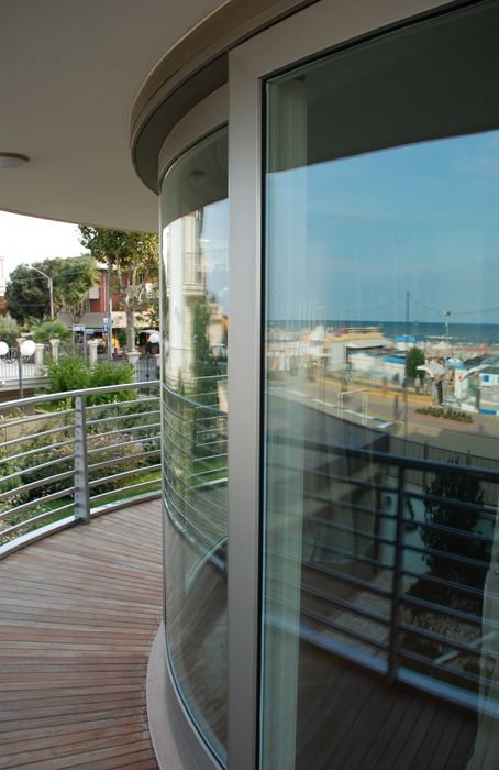 Albertini curved-in-plan lift and slide window cladded with Aluminium to give external protection.