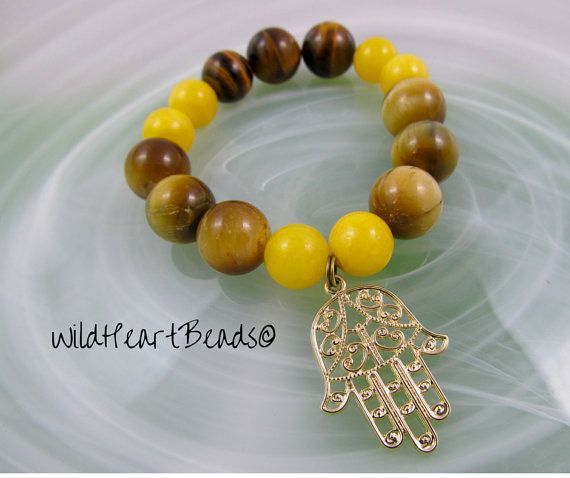 Gold Hamsa Bracelet - Protection Hand - Yellow Gold Beads - Tiger eye Jewelry - Handmade Boho Bracelet - Large Beaded Large Hamsa Hand Charm Now is the perfect time to shop for gifts for your loved ones!! Christmas coupons are back!! SANTA001 for 10% off any order! Every bracelet now comes with a FREE gemstone pendant and matching earrings!! FREE SHIPPING WITHIN CANADA!! Order now :D