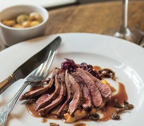 Crown of duck with red cabbage and sautéed potatoes