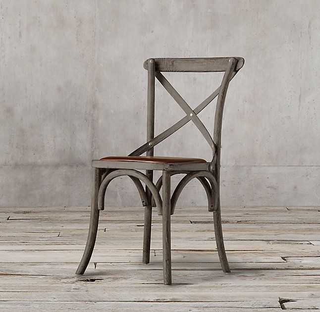 RH's Madeleine Leather Side Chair:Modeled after the most popular café chair in Europe, our versatile X-back dining chair pays homage to the bentwood tradition popularized by Thonet in 19th-century Austria. Handsomely distressed with a weathered finish.