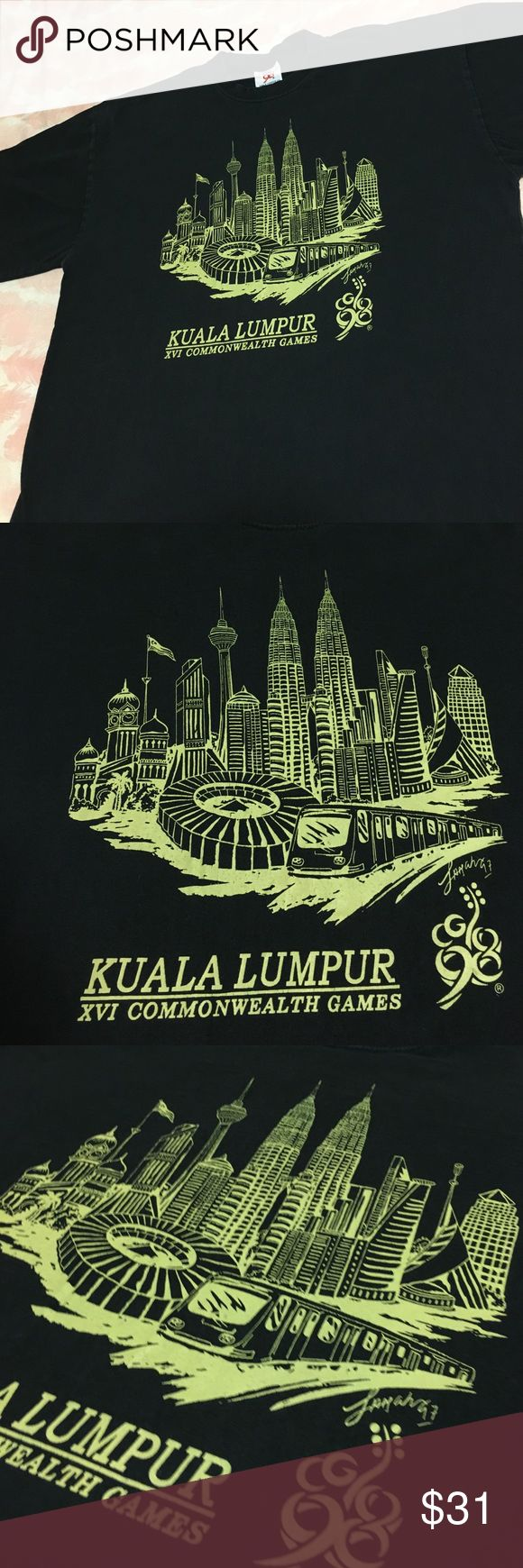 1998 Commonwealth Games😎Khala Lumpur Masterpiece Omgness , this baby is fire 🔥 Commonwealth Games 1998 with that awesome front logo . Light fade to this black beauty . XL & legit as it gets 😇 Vintage Tops Tees - Short Sleeve
