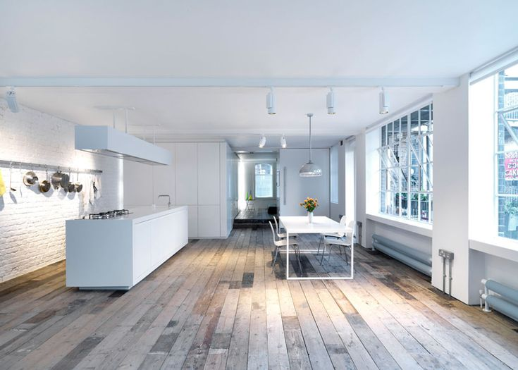 Loft apartment by Form Design Architecture with reclaimed floorboards
