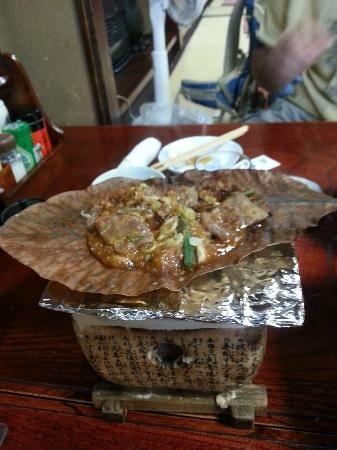 Hidatakayama Kyoya restaurant with Hida beef cooked on magnolia leaf.