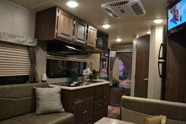 2017 Shamrock FLT19 Expandable Hybrid Travel Trailer  This Hybrid Travel Trailer features two 60x80 tent ends, a booth dinette and a Jack Knife sofa to easily accommodate sleeping for 6. The kitchen has a double sink with a cover, a 3 burner cook top, microwave and a 2 door refrigerator. The bathroom has a gorgeous glass enclosed shower with a sky light, a sink with a vanity/medicine cabinet, and a large linen closet.
