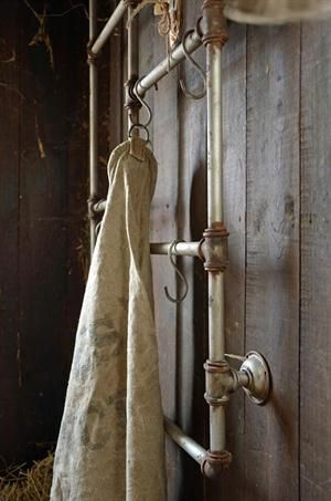 """Pipe Wall Merchandiser        30.5"""" x 3"""" x 48.5 Metal Pipe wall merchandiser w/hooks for hanging things..such as bags, belts scarves etc."""