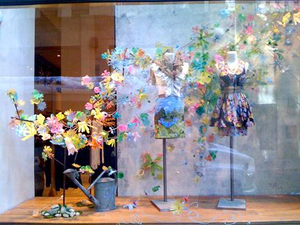 Anthropologie window display flowers made from plastic for Anthropologie store decoration ideas