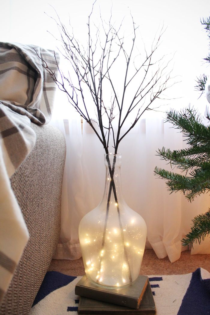 A simple DIY holiday home tour. Get in the spirit and cozy up your home with just a few holiday decorations. These homemade borax icicles and mercury glass ornaments are easy and affordable to make! The neutral decorations are perfect all winter long. amandakatherine.com