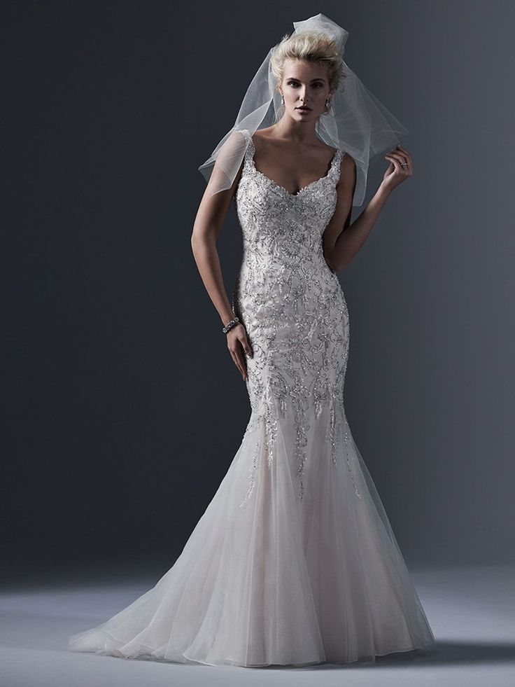 Sottero and Midgley - HOLLAND, Lace appliqués; decadently embroidered with dramatic sequins and Swarovski crystals; adorn the bodice of this tulle fit and flare wedding dress; with daring scoop back and romantic sweetheart neckline. Finished with crystal buttons over zipper closure.